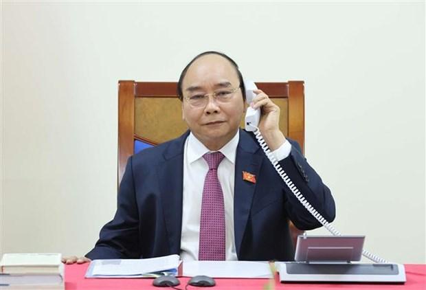 ASEAN 2020:政府总理阮春福与老挝总理通伦·西苏里通电话 hinh anh 2