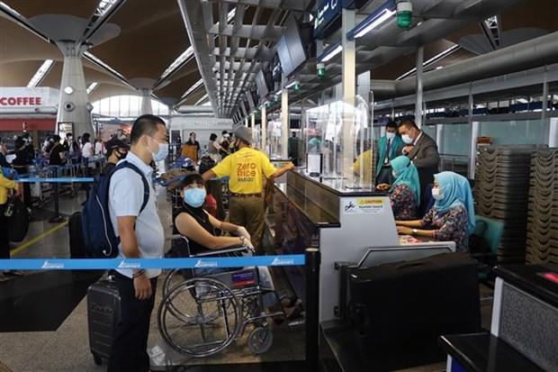 新冠肺炎疫情:将在马来西亚的290名越南公民接回国 hinh anh 1