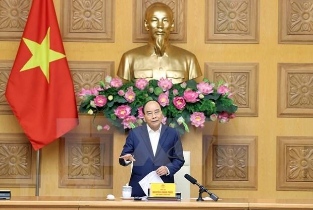 政府总理阮春福会见纺织品服装和皮革鞋类企业代表 hinh anh 1
