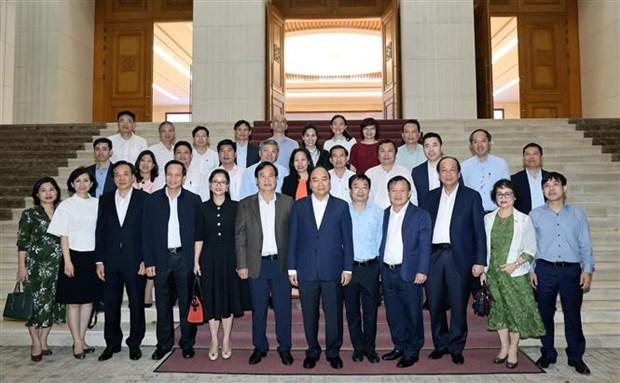 政府总理阮春福会见纺织品服装和皮革鞋类企业代表 hinh anh 2
