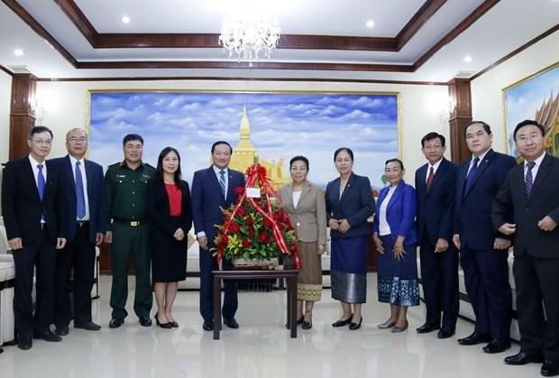老挝高度评价越南在该国45年来国家发展过程中留下的烙印 hinh anh 1