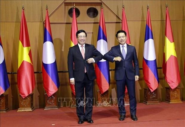 第七次越老外交部部长级政治磋商在万象举行 hinh anh 1