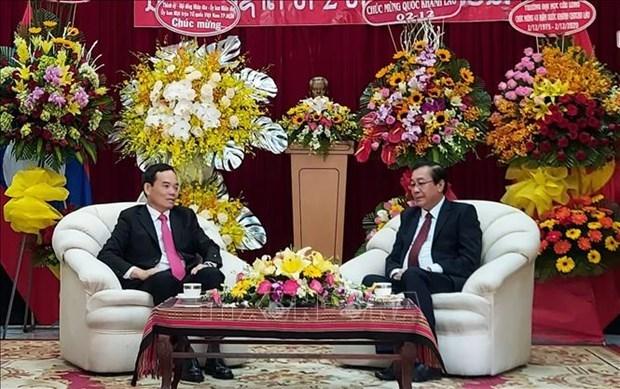 胡志明市领导庆祝老挝国庆节45周年 hinh anh 1