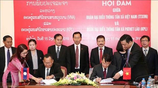 越通社与老挝国家通讯社合作在越老两国特殊友谊历史进程中成长 hinh anh 2