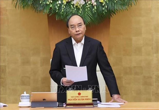 政府总理阮春福:有效展开灾后重建工作 hinh anh 1
