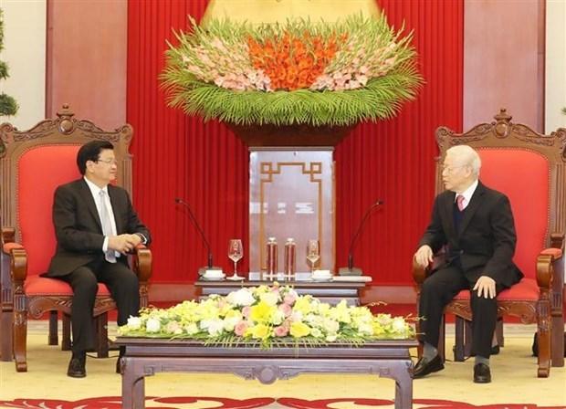 越共中央总书记、国家主席阮富仲会见老挝政府总理通论·西苏里 hinh anh 2