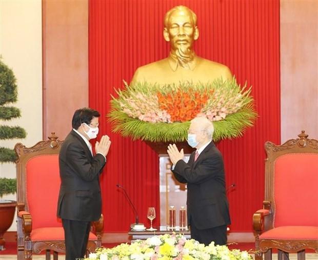 越共中央总书记、国家主席阮富仲会见老挝政府总理通论·西苏里 hinh anh 1