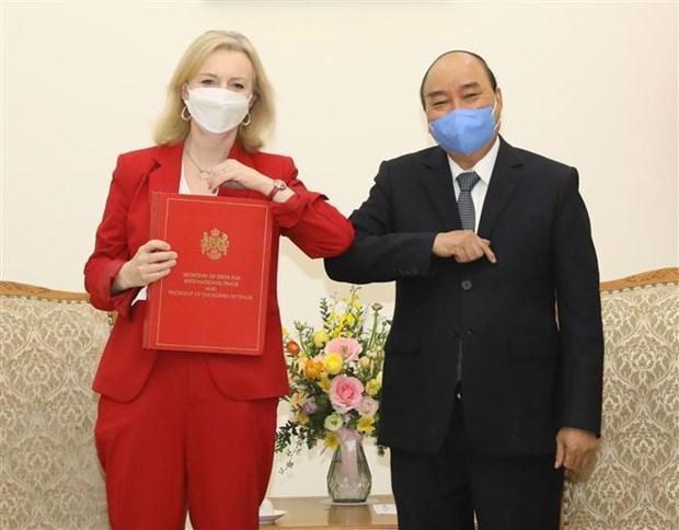 英国国际贸易大臣:英国将越南视为可信任且稳固的伙伴 hinh anh 1