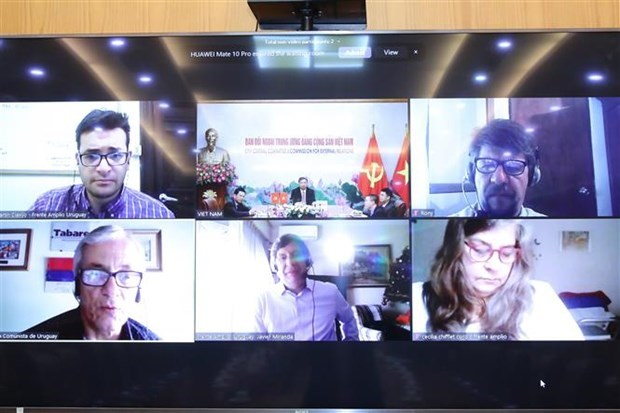 越共中央对外部领导与乌拉圭政党领导举行视频会谈 hinh anh 2