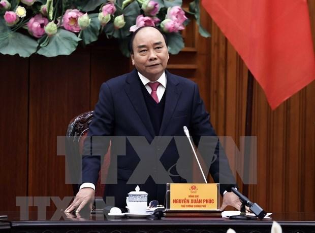 越南政府总理阮春福: 应采取强有力的措施和合适的方式推进国内新冠疫苗试验进程 hinh anh 1