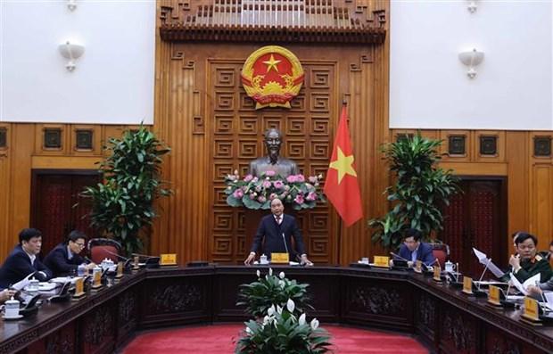越南政府总理阮春福: 应采取强有力的措施和合适的方式推进国内新冠疫苗试验进程 hinh anh 2