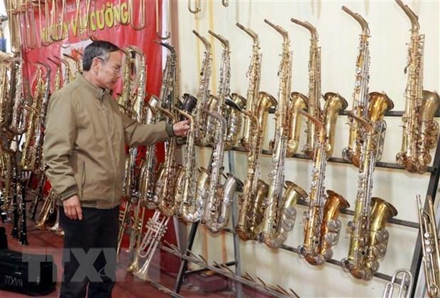 南定省范炮村努力弘扬西洋管乐器生产业 hinh anh 2