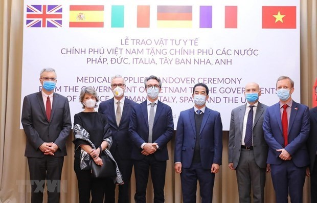越南与国际携手应对新冠肺炎疫情 hinh anh 1