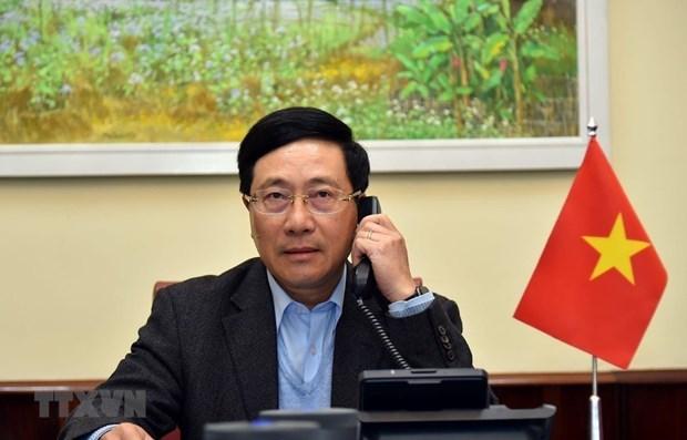 越南政府副总理兼外长范平明与美国国家安全顾问罗伯特·奥布莱恩通电话 hinh anh 1
