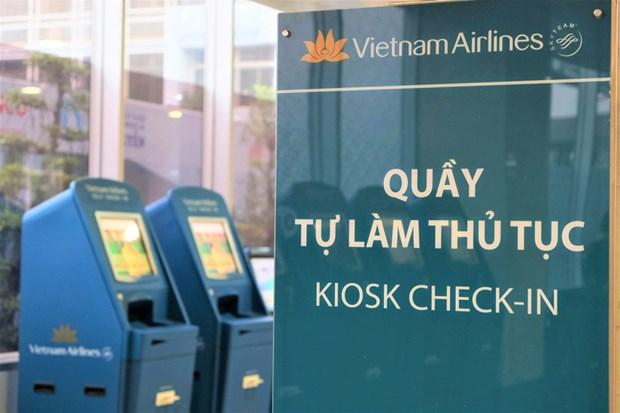 越航在吉碑国际机场开展自助机办理登机手续服务 hinh anh 1