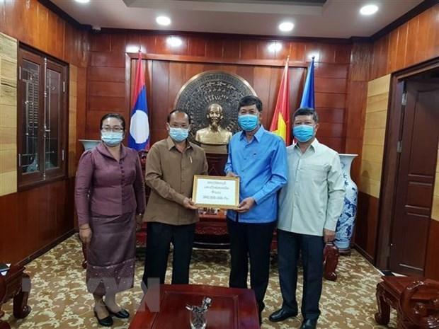 老挝与越南携手抗击新冠肺炎疫情 hinh anh 2