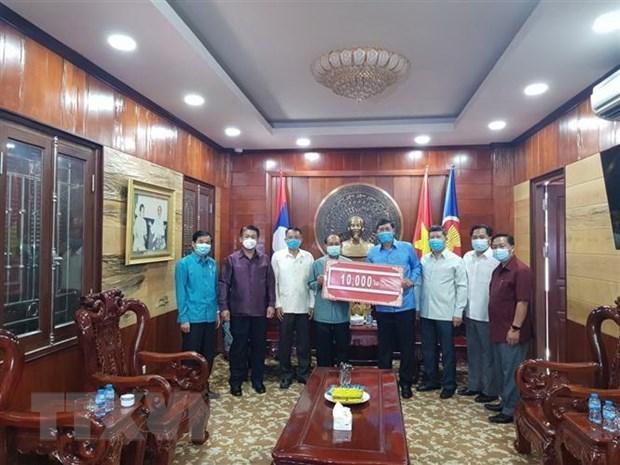 老挝与越南携手抗击新冠肺炎疫情 hinh anh 1