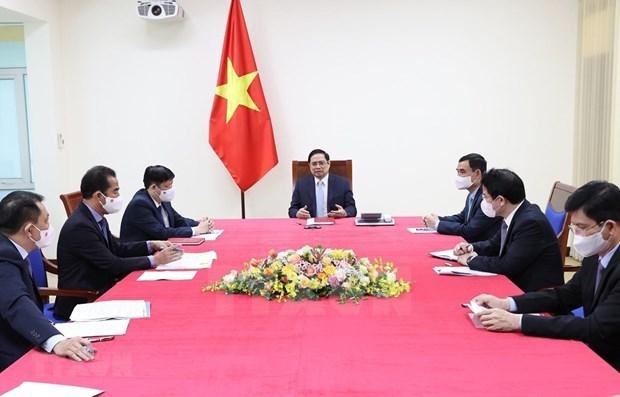 越南政府总理范明政与法国总理让·卡斯特克斯通电话 hinh anh 1