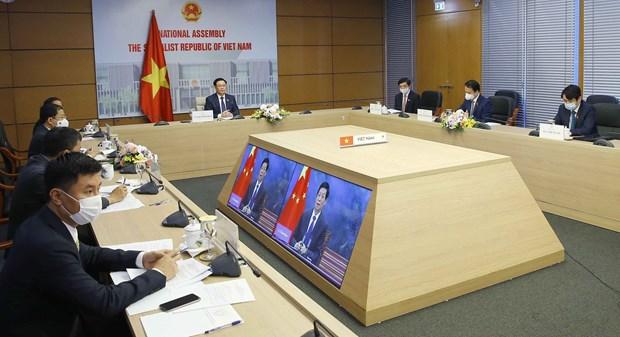 越南国会主席王廷惠与中国全国人大常委会委员长栗战书举行视频会谈 hinh anh 1