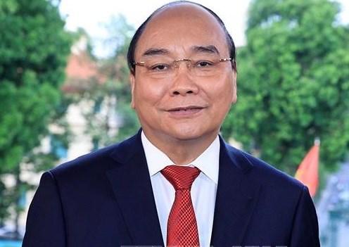 阮春福赞扬新闻媒体在新冠肺炎疫情防控阻击战中的重要作用 hinh anh 1