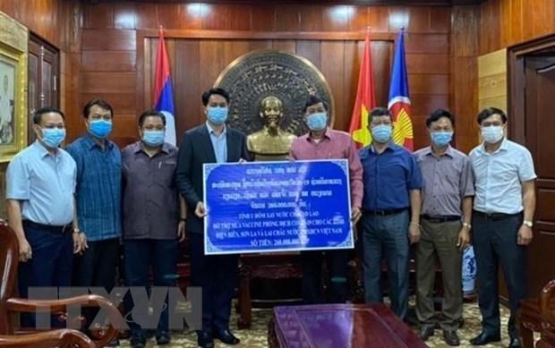 老挝为越南新冠肺炎疫情防控提供援助 hinh anh 1