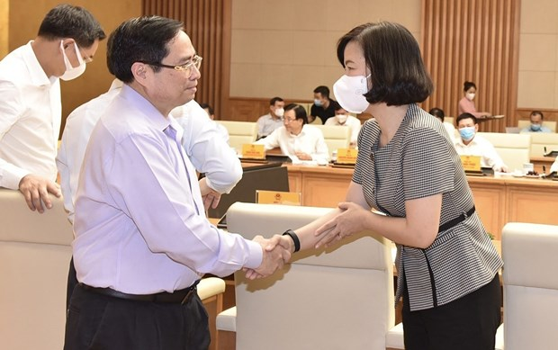 政府总理范明政:政府高度评价新闻机构的活动并为其创造有利条件 hinh anh 1