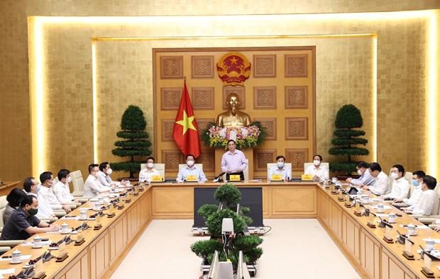 政府总理范明政:政府高度评价新闻机构的活动并为其创造有利条件 hinh anh 2