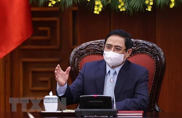 政府总理范明政:越南疫情防控工作取得积极成果 hinh anh 1