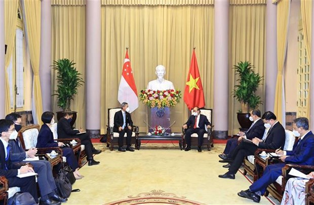越南国家主席阮春福会见新加坡外长 hinh anh 2