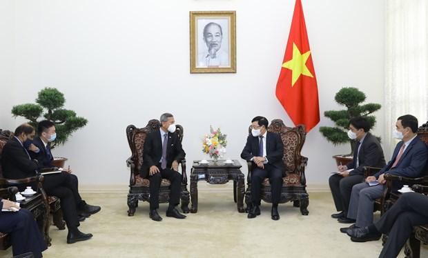 政府副总理范平明会见新加坡外交部长维文 hinh anh 1