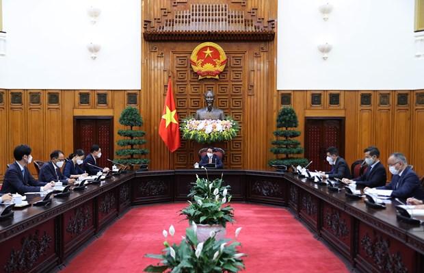 越南政府总理范明政会见韩国外交部长官郑义溶 hinh anh 2