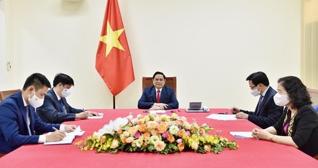 越南政府总理范明政建议世卫组织援助越南成为疫苗生产中心 hinh anh 1