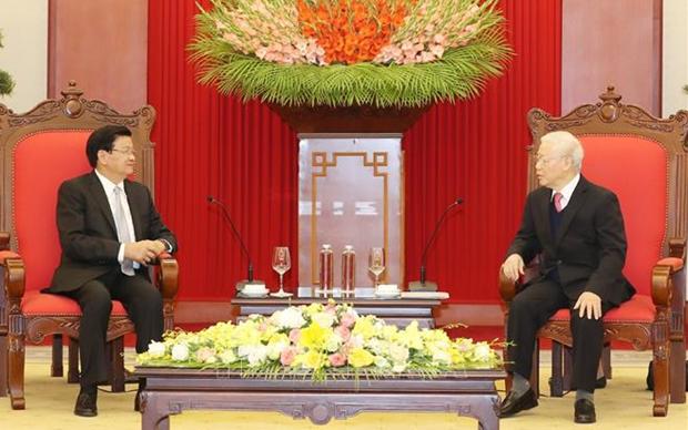 老挝人民革命党中央总书记、国家主席即将访越:为密切越老信任关系做出贡献 hinh anh 1