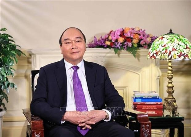 越南国家主席:疫情之下家庭是帮助战士们、医生们出色完成任务的靠山 hinh anh 1