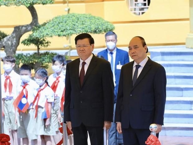 老挝媒体:通伦·西苏里访越之旅彰显老挝在维护与发展越老传统关系的一贯立场 hinh anh 1
