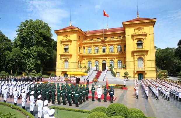 越南国家主席阮春福与夫人主持仪式欢迎老挝党中央总书记、国家主席访越 hinh anh 1