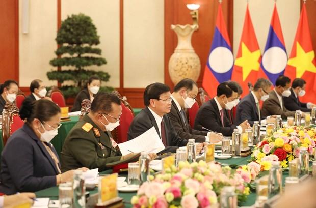 越共中央总书记阮富仲与老挝人民革命党总书记、国家主席通伦举行了会谈 hinh anh 2