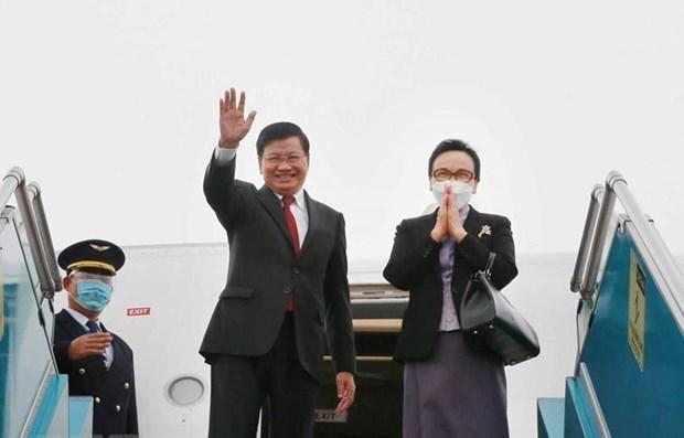 老挝人民革命党中央总书记、国家主席通伦·西苏里圆满结束对越南进行的正式友好访问 hinh anh 1