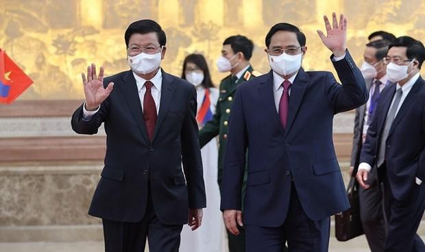 老挝领导访越之旅是两个民族的新历史里程碑 hinh anh 3