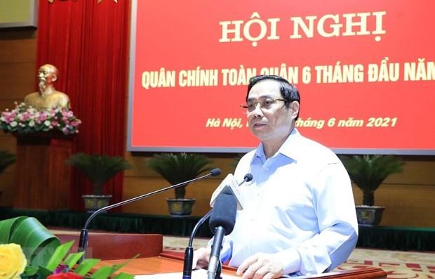 政府总理范明政:军队为国家的成就做出积极贡献 hinh anh 1