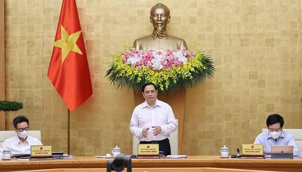 越南政府总理范明政主持政府6月例行会议 hinh anh 1