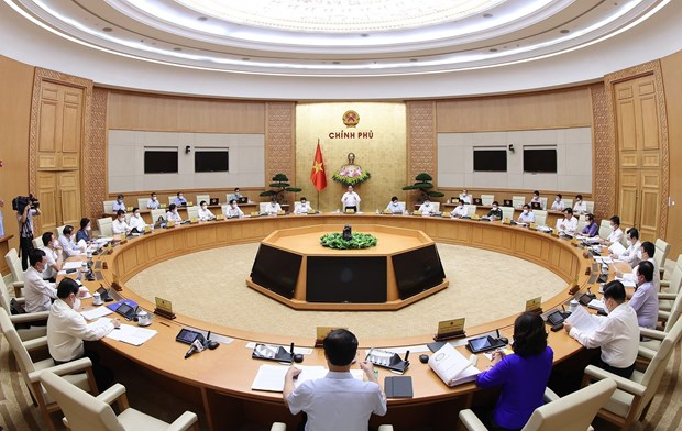 越南政府总理范明政主持政府6月例行会议 hinh anh 2