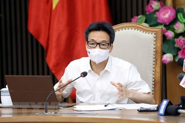 政府副总理武德儋:胡志明市需采取更强有力的措施 尽早控制住疫情 hinh anh 1