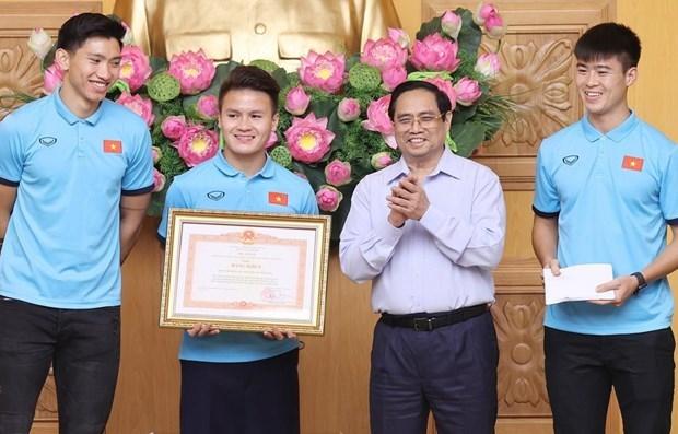 政府总理范明政:体育有助于加强民族大团结 展现越南人意志和毅力 hinh anh 1