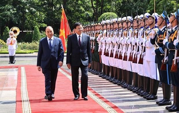 老挝媒体:老越特殊团结与全面合作关系日益密切 hinh anh 2