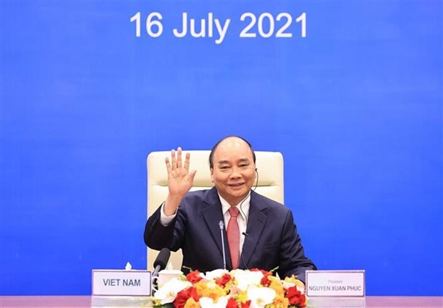 越南国家主席阮春福在河内以视频方式出席亚太经合组织领导人非正式会议 hinh anh 2