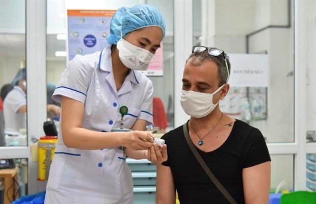 胡志明市着力为外籍人士制定疫苗接种计划 hinh anh 1