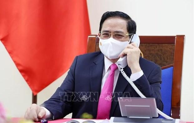 越南政府总理范明政与韩国总理金富谦通电话 hinh anh 1