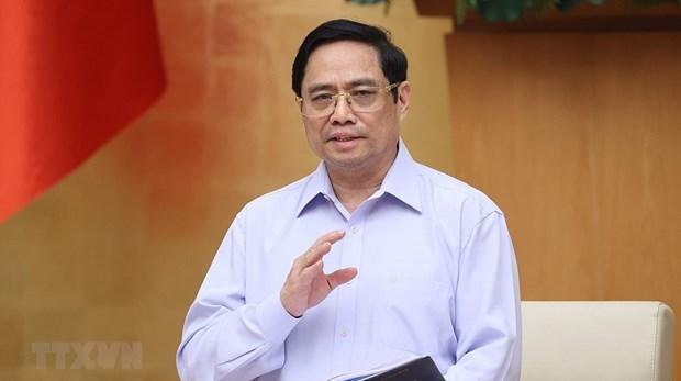 越南政府总理范明政致公开信激励抗疫一线人员 hinh anh 2