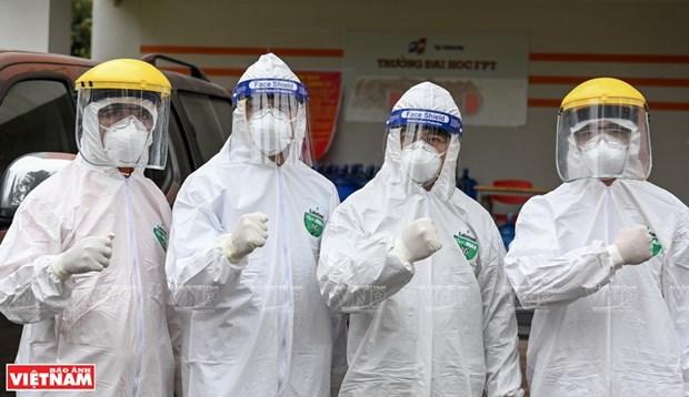 越南政府总理范明政致公开信激励抗疫一线人员 hinh anh 1